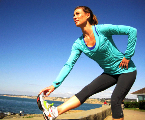 A female runner stretching before a run; photo courtesy Michelle Rebecca