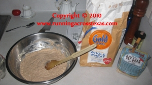 Pizza ingredients and the dough mixing bowl