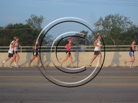 Runners on the Kemah Bridge crossing to Seabrook