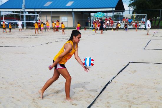 Summer sand volleyball serving; image © KSmith Media, LLC