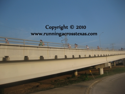 Runners on the Kemah Bridge at the 2009 Toughest 10K; photo © KSmith Media, LLC